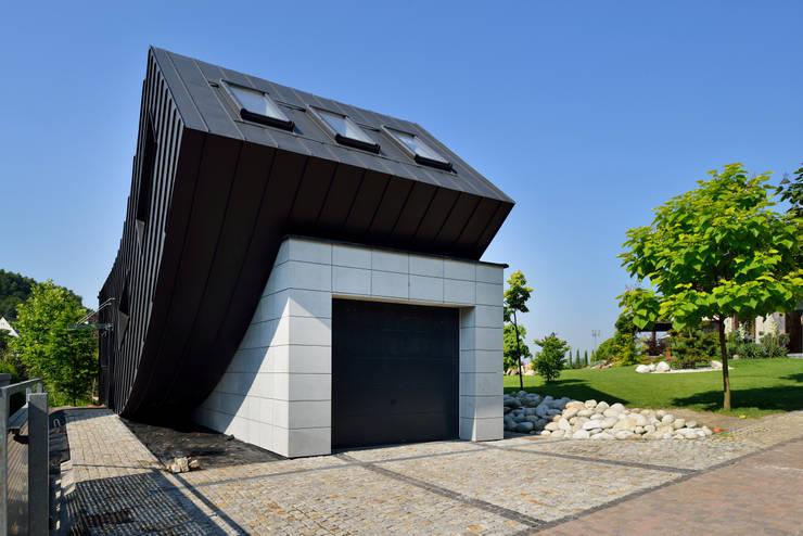 Domo Dom: styl minimalistyczne, w kategorii Domy zaprojektowany przez ARCHITEKT.LEMANSKI