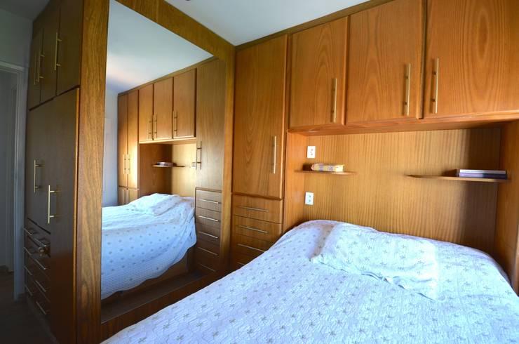 Dormitório do casal: Quartos  por Natali de Mello - Arquitetura e Arte,