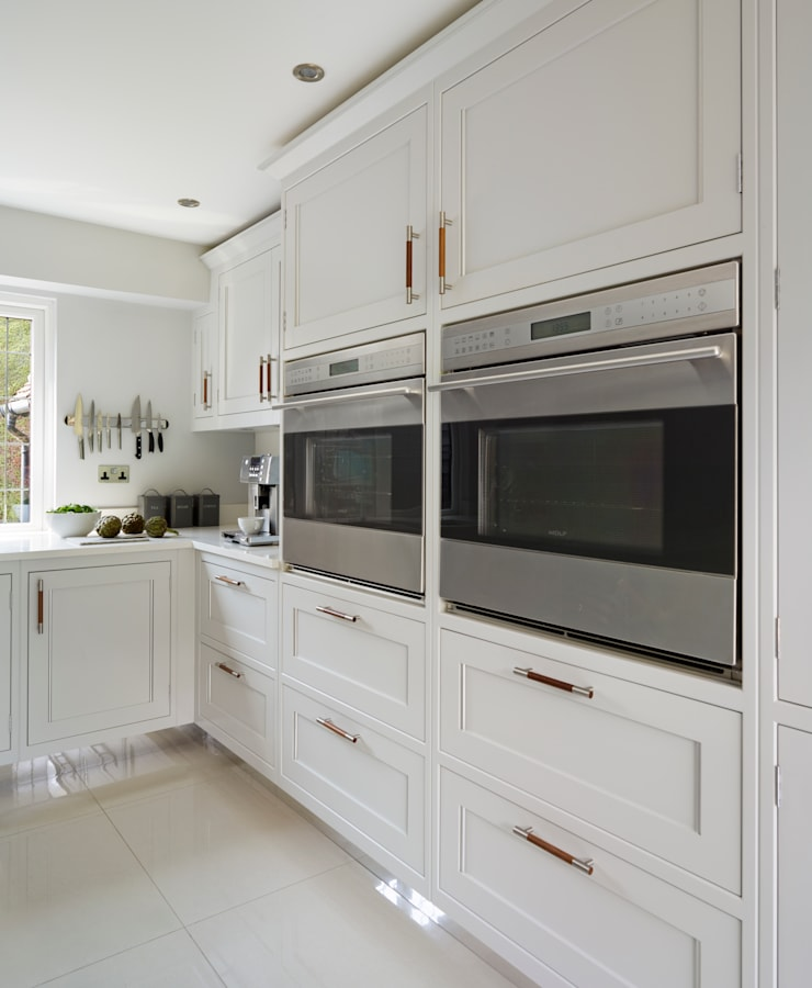 House transformation.:  Kitchen by Moneyhill Interiors