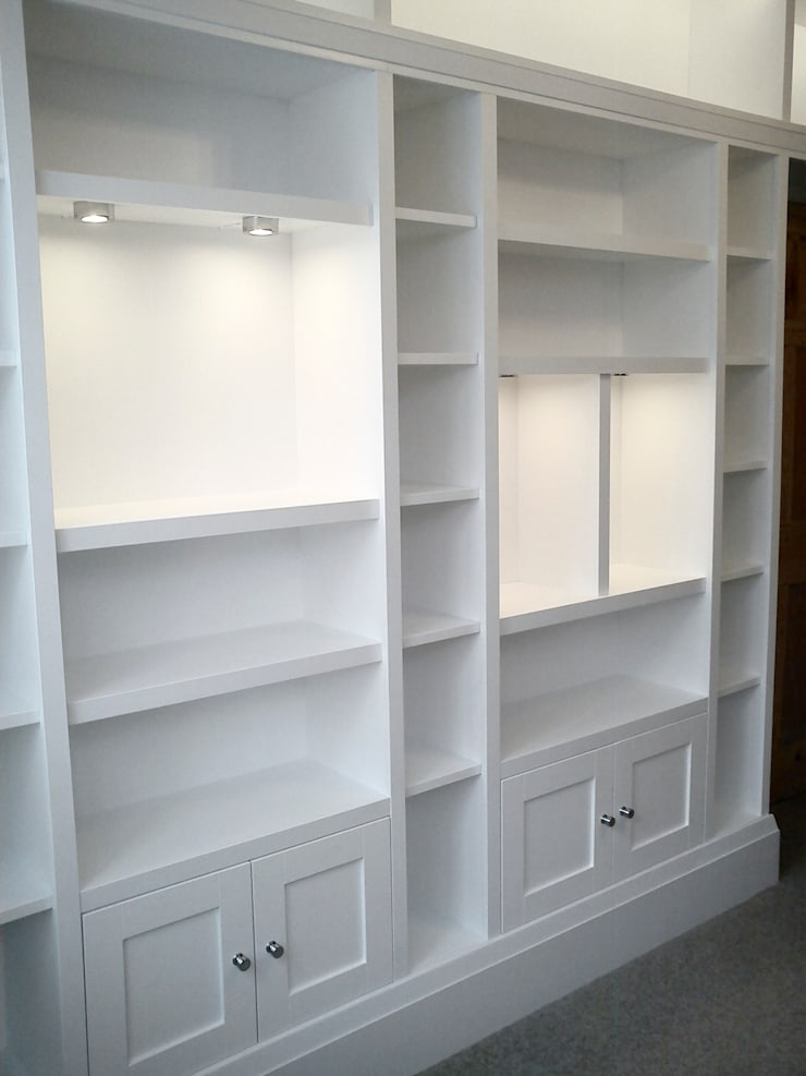 Chunky white fitted shelving units and cupboards:  Study/office by Freebird Fitted Furniture