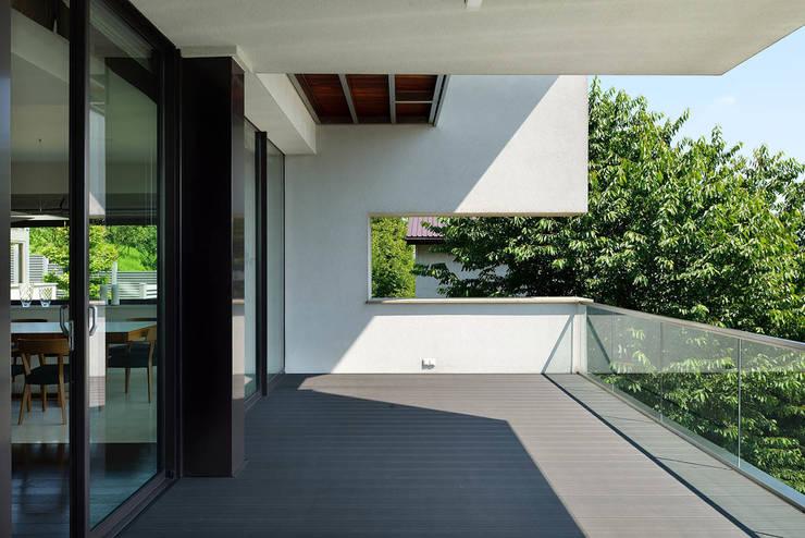GG House: styl minimalistyczne, w kategorii Domy zaprojektowany przez ARCHITEKT.LEMANSKI