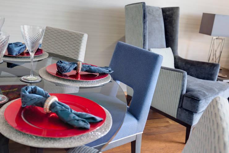 Coordinated dining:  Dining room by Design by Deborah Ltd