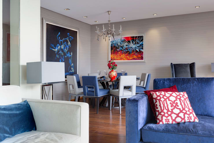 Modern dining room with contrasting bright art to the neutral walls:  Dining room by Design by Deborah Ltd