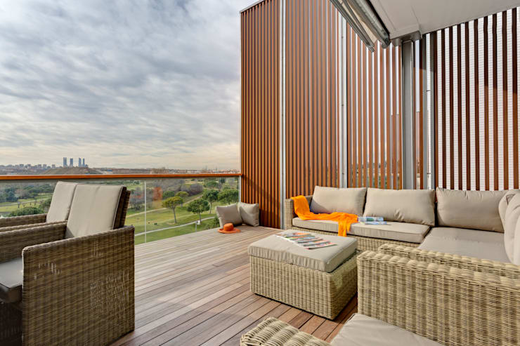 A Spectacular View - Madrid Apartment:  Terrace by Design by Deborah Ltd