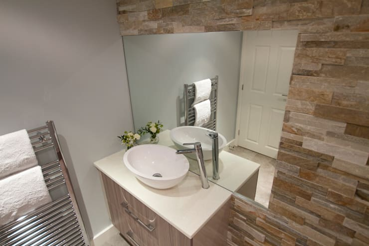 Textured Wall Tiles Create Calm Interest in this Cloakroom.:  Bathroom by Design by Deborah Ltd