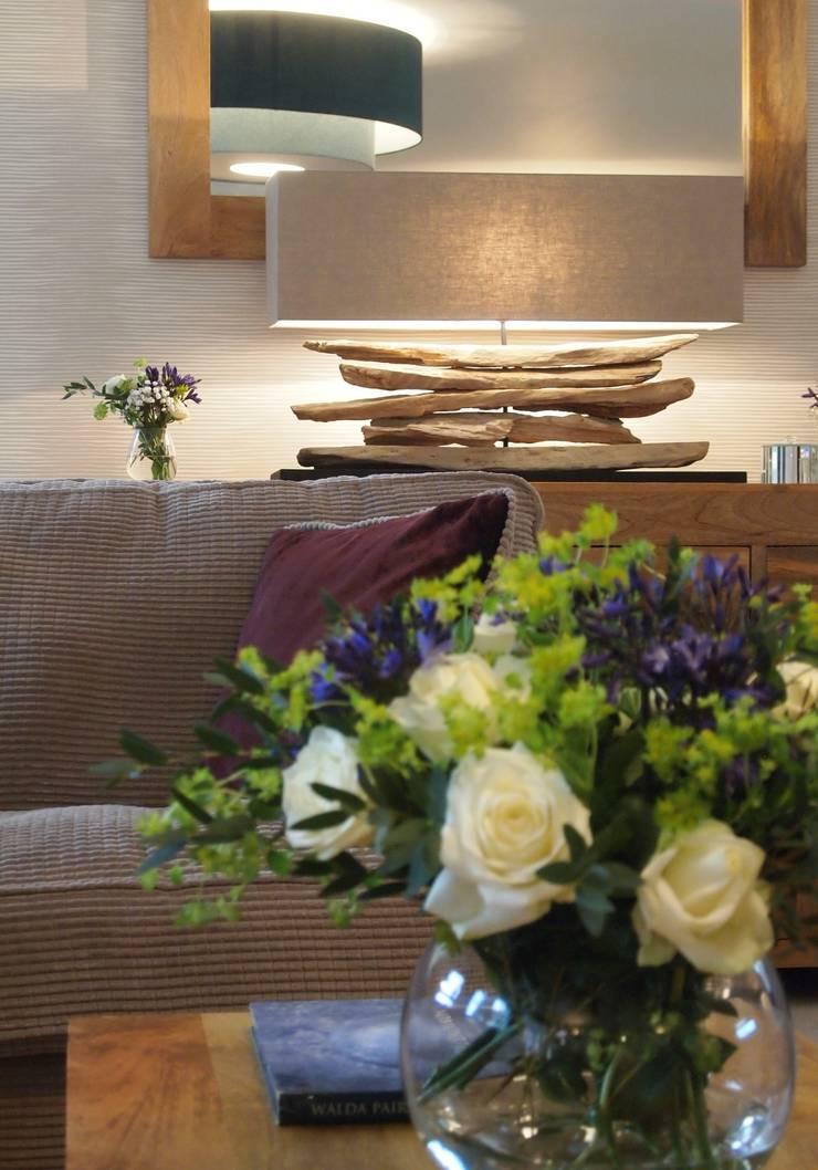 An Interesting Driftwood Lighting Piece:  Living room by Design by Deborah Ltd