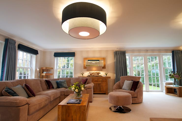 An Extra Large Lighting Shade Adds a Boutique Finish:  Living room by Design by Deborah Ltd