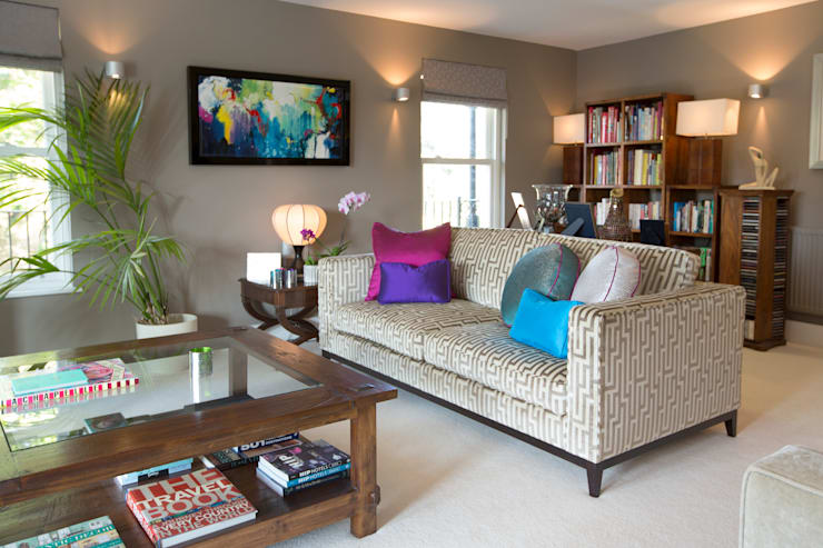 Neutral with Splashes of Jewel Colours in the Cushions and Art:  Living room by Design by Deborah Ltd