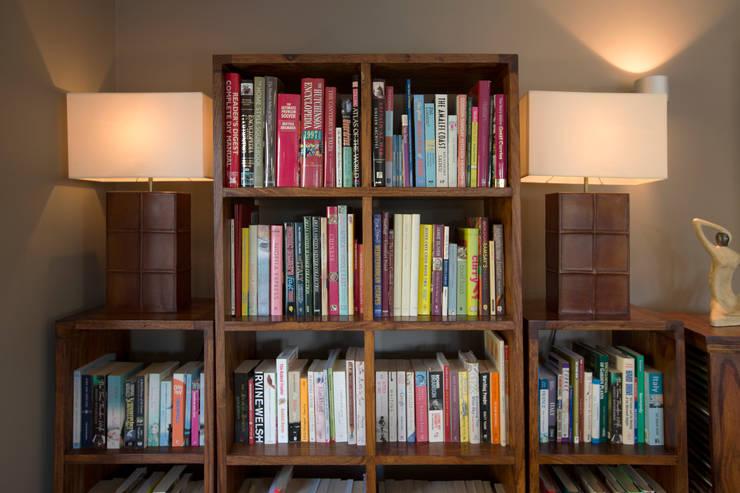Simple Dark Wood Cube Shelving:  Living room by Design by Deborah Ltd