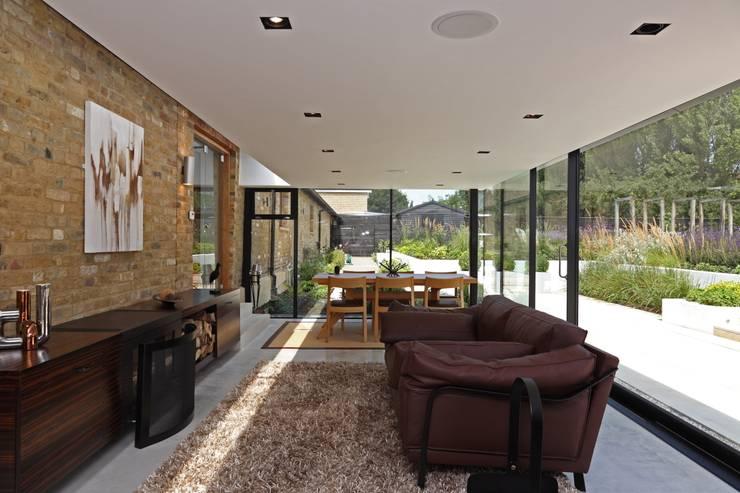 Salas / recibidores de estilo  por Nicolas Tye Architects