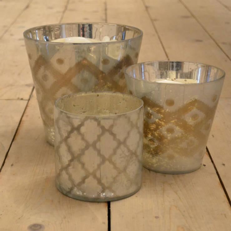 glass votive candle holders:  Living room by Tina Bucknall