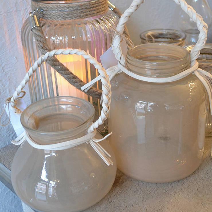 Coloured glass lanterns:  Living room by Tina Bucknall