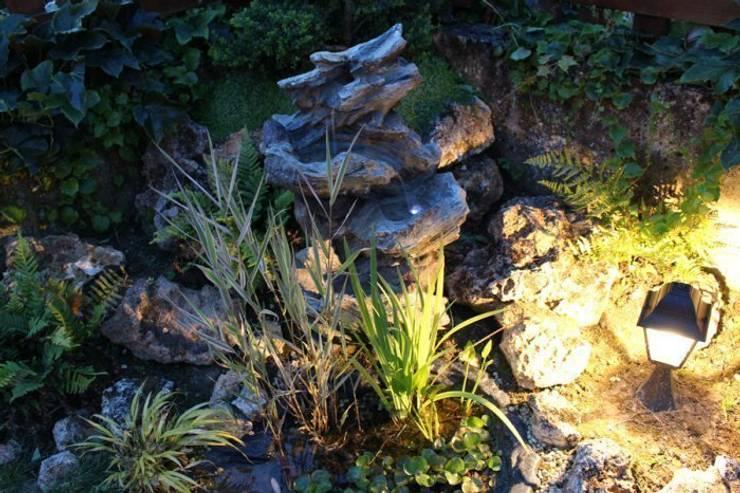 Jardins  por SAS Glenn Tay Paysagiste
