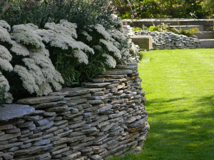 Dry stone wall and sedums.:   by Westacott Gardens