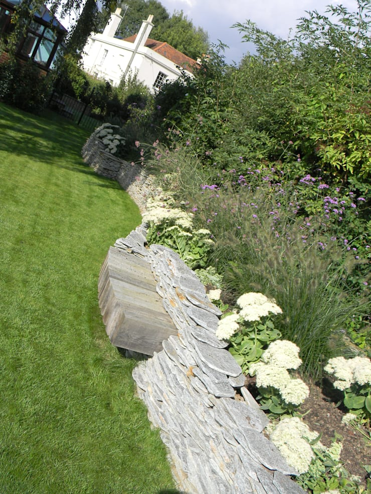 Dry stone wall with built in bench.:   by Westacott Gardens