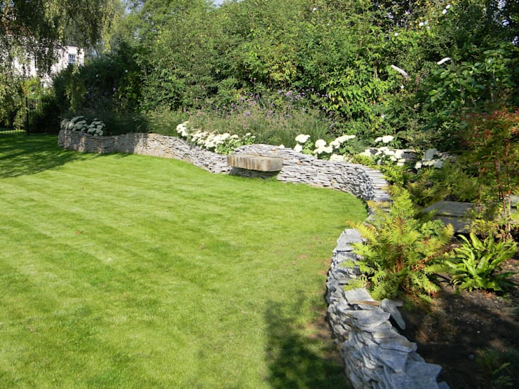 Sympathetic design for a large family garden:   by Westacott Gardens