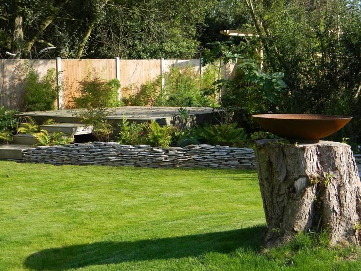 View of steel birdbath and decks.:   by Westacott Gardens
