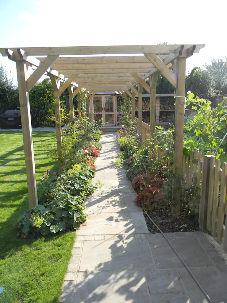 New pergola and herbaceous planting.:   by Westacott Gardens