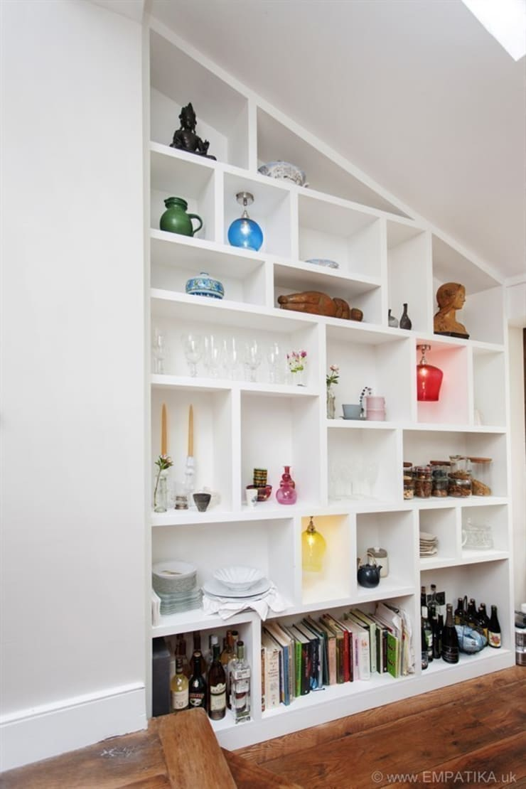 Bespoke shelving with random compartments.:  Living room by Empatika