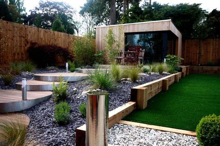 Landscaped family garden room space:  Garden by The Swift Organisation Ltd