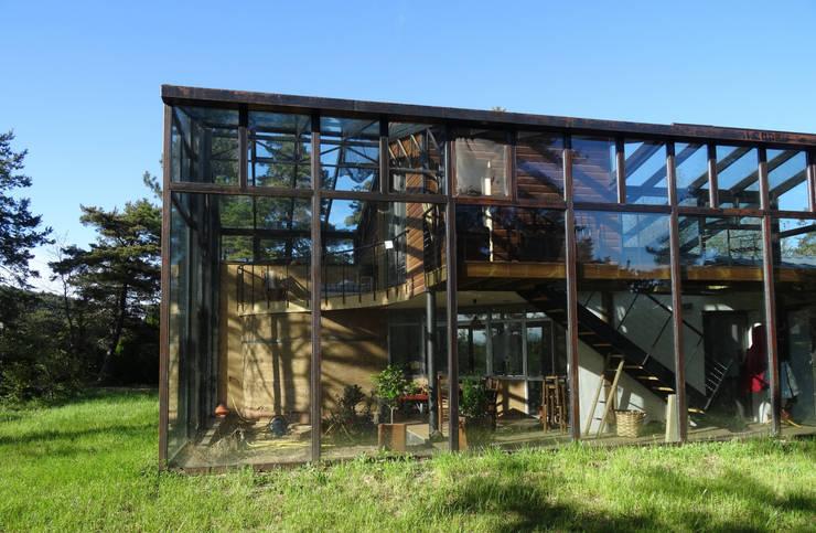 Maison bois sous verre...: Maisons de style  par eco-designer
