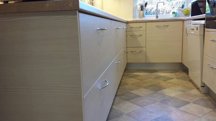 Brushed Aluminum plinths:   by The Kitchen Makeover Shop Ltd