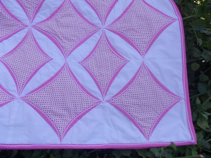 Detail of pink Cathedral window quilt:  Bedroom by Lilliputquilts