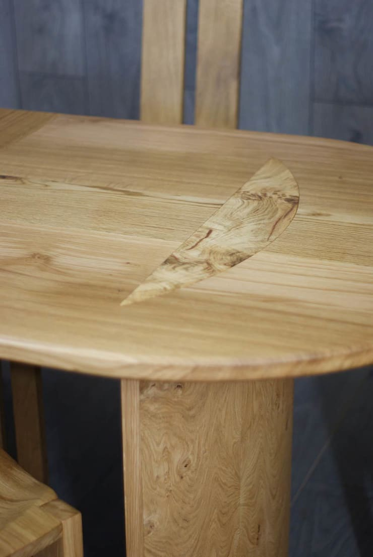 Prideaux extending oak dining table and eight chairs :  Dining room by Lee Sinclair Furniture