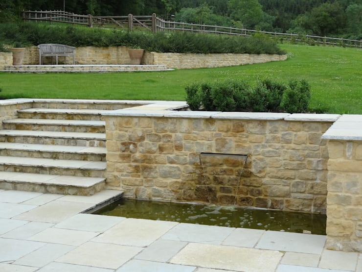 Somerset Farmhouse - Rear terrace water feature:  Terrace by Laurence Maunder Garden Design & Consultancy