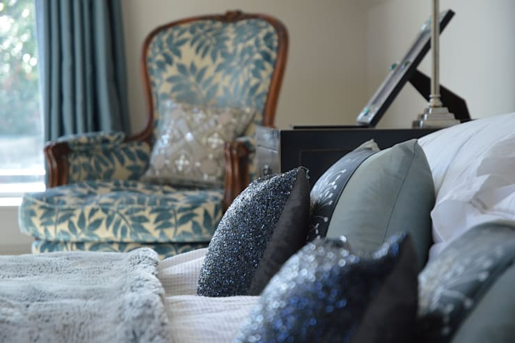 Close  up of bed and chair :  Bedroom by Zodiac Design