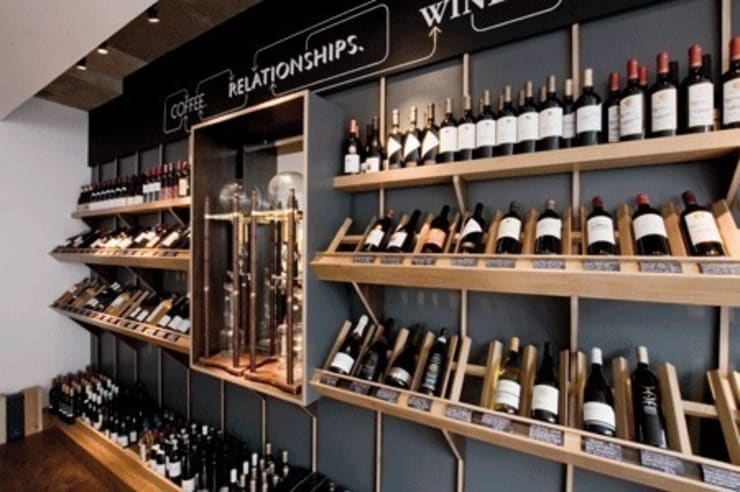 wine wall:  Bars & clubs by Engaging Interiors Limited
