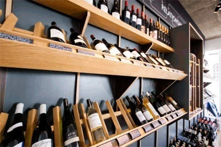 wine display:  Bars & clubs by Engaging Interiors Limited