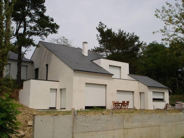 Maison à Vigneux De Bretagne 44: Maisons de style  par Archimat Creation