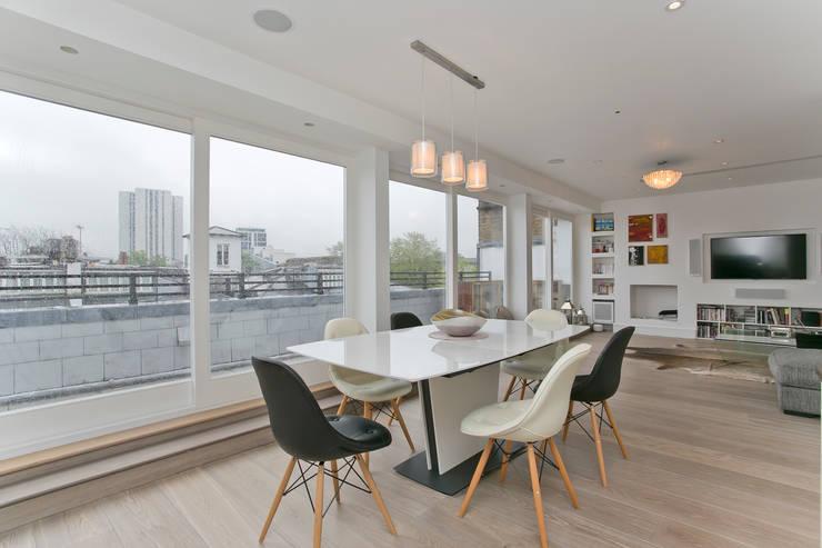 Salle à manger de style  par Temza design and build, Moderne