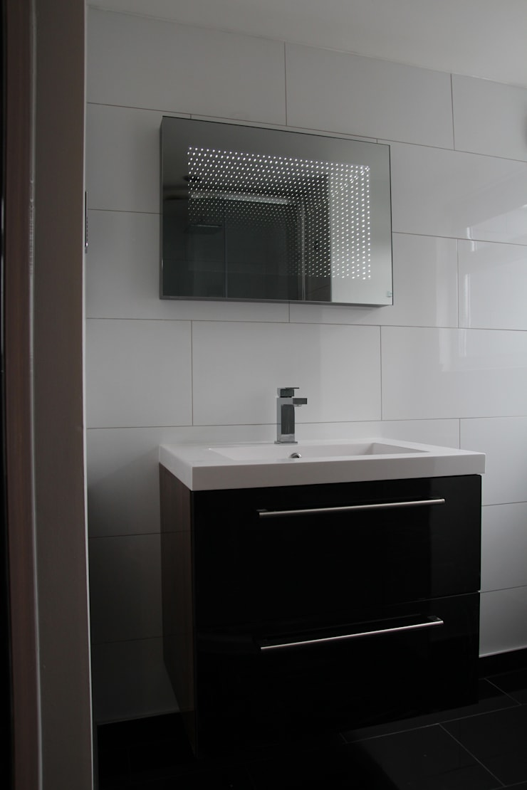 House in Tooting:  Bathroom by Bolans Architects