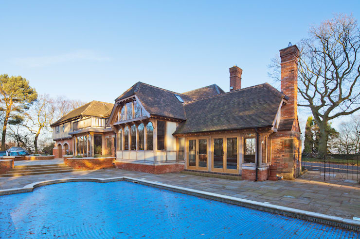 Traditional oak-frame home with swimming pool:   by Welsh Oak Frame