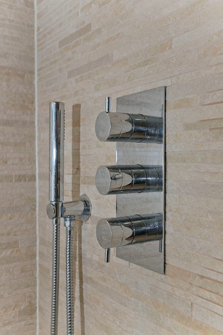 Hand shower in bathroom 1:  Bathroom by Temza design and build