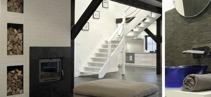 Salon w domu nad jeziorem w Miłomłynie - schody: styl , w kategorii Korytarz, przedpokój zaprojektowany przez Paszkiewicz Design