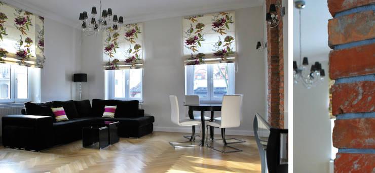 Apartament w Sopocie - salon z jadalnią: styl , w kategorii Salon zaprojektowany przez Paszkiewicz Design