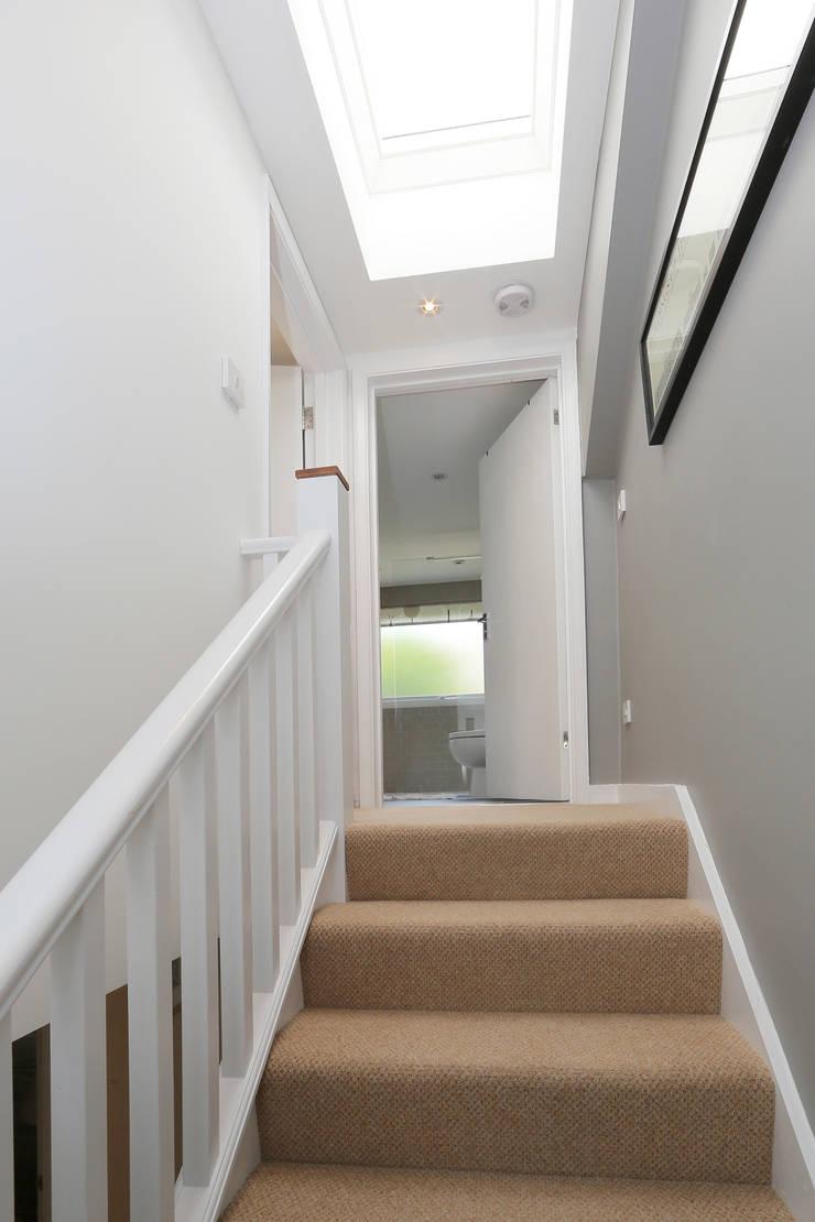 dormer loft conversion wandsworth:  Corridor & hallway by nuspace