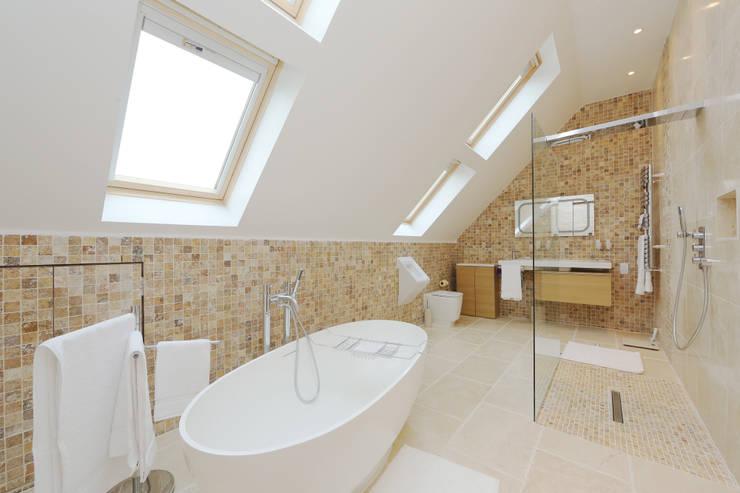 velux loft conversion surrey:  Bathroom by nuspace