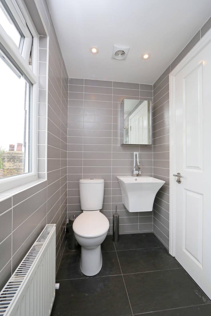 hip to gable loft conversion wimbledon:  Bathroom by nuspace