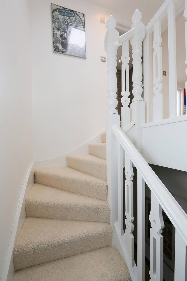 hip to gable loft conversion wimbledon:  Corridor & hallway by nuspace