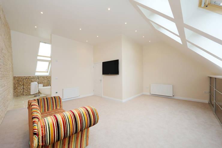 velux loft conversion surrey:  Bedroom by nuspace