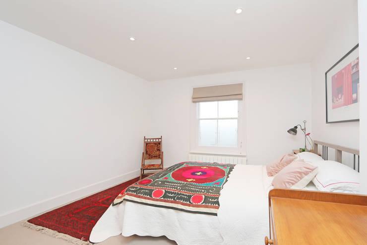 mansard loft conversion wandsworth: modern Bedroom by nuspace