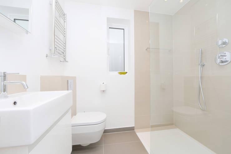 mansard loft conversion wandsworth: modern Bathroom by nuspace