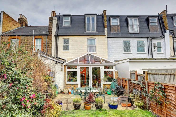mansard loft conversion wandsworth:  Houses by nuspace