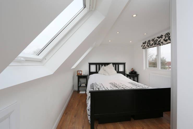 l-shaped dormer loft conversion richmond:  Bedroom by nuspace