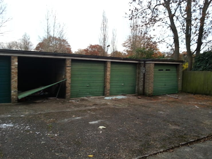 Abandoned and unsighlty garages:   by PAD ARCHITECTS