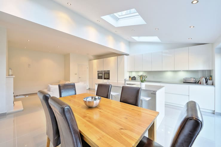 kitchen rear extension ealing with pitched roof:  Kitchen by nuspace
